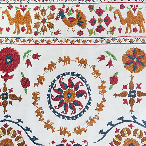 Silk hand embroidered suzani with camel motifs