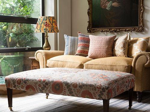 Medium sized ottoman footstool in silk hand embroidered suzani