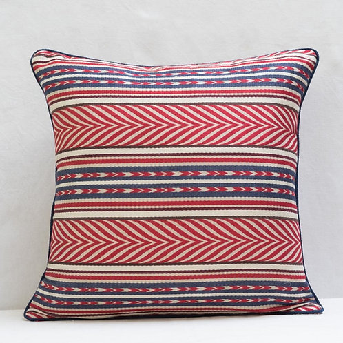 Red blue cream Aztec fabric cushion piped in navy