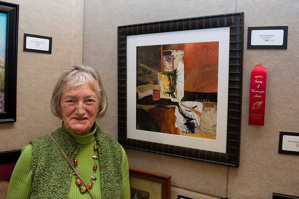 image of Carolyn Macpherson with her 2nd place painting Oriental Balance