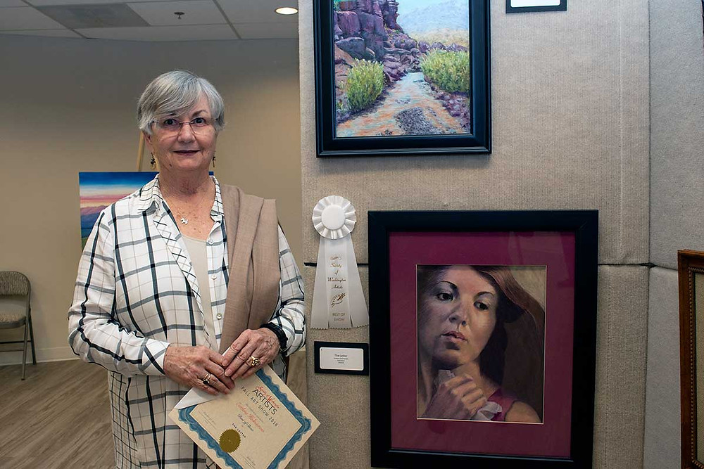 image of Earlene Holmstrom with her Best in Show painting