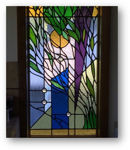 Custom stained glass window by Greg Lewis