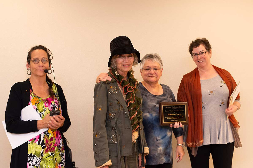 image of Marianne Stockes accepting her Sharon Whyte award of appreciation - L to R: Rae Del Brashier, Marianne Stokes, Wanda Brewster and Janice Tracy