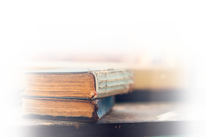 graphicstock-stack-of-old-books-laid-on-