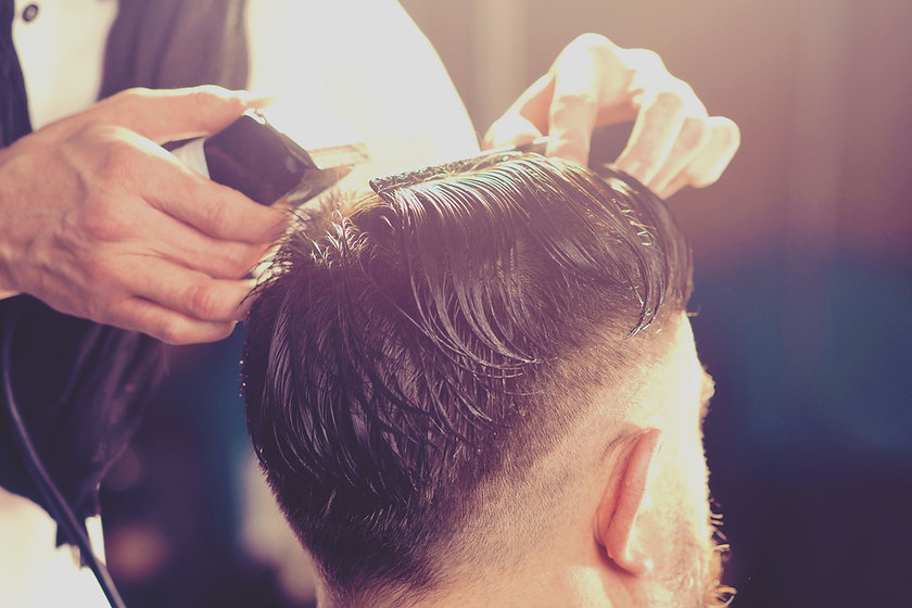 Man in barbers getting his hair cut