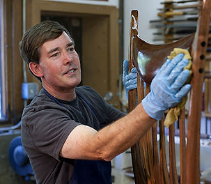 Mike Johnson oiling a Rocking Chair