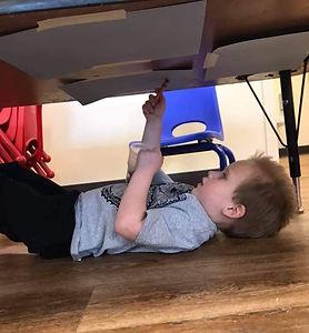 ryker under table_edited.jpg