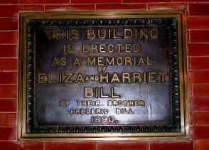 """The dedication plate for the Library, which read: """"This building is erected as a memorial of Eliza and Harriet Bill"""""""