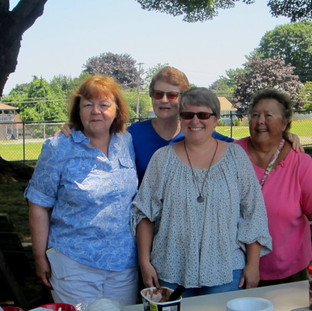 Board Members serving ice cream at our popular summer reading wrap-up