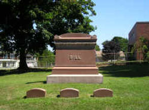 The family headstone and burial markers for the Bill family