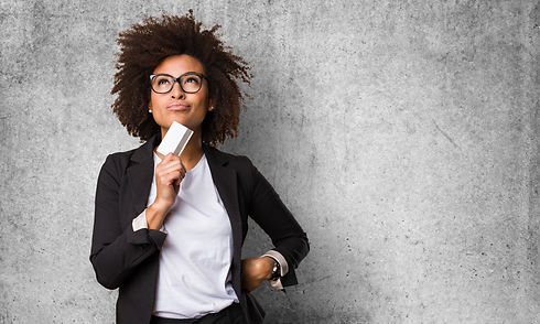 business black woman holding a credit ca