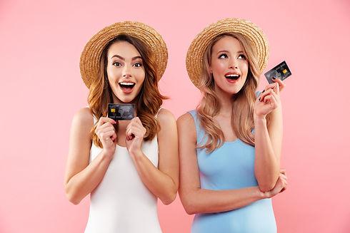 Portrait of a two satisfied girls dresse