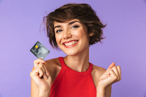 Smiling Pretty brunette woman holding cr