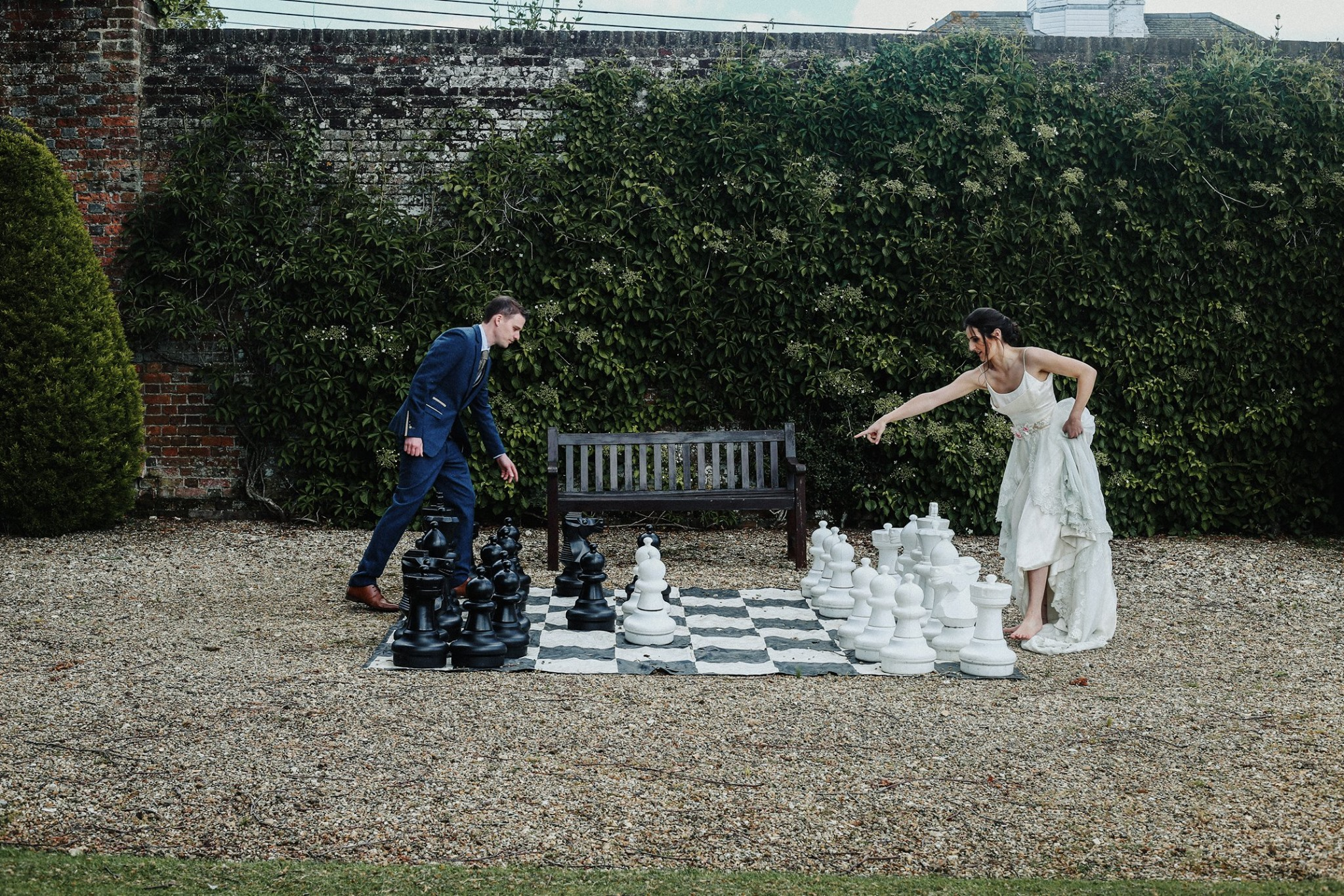 Bride and groom giant playing giant chess
