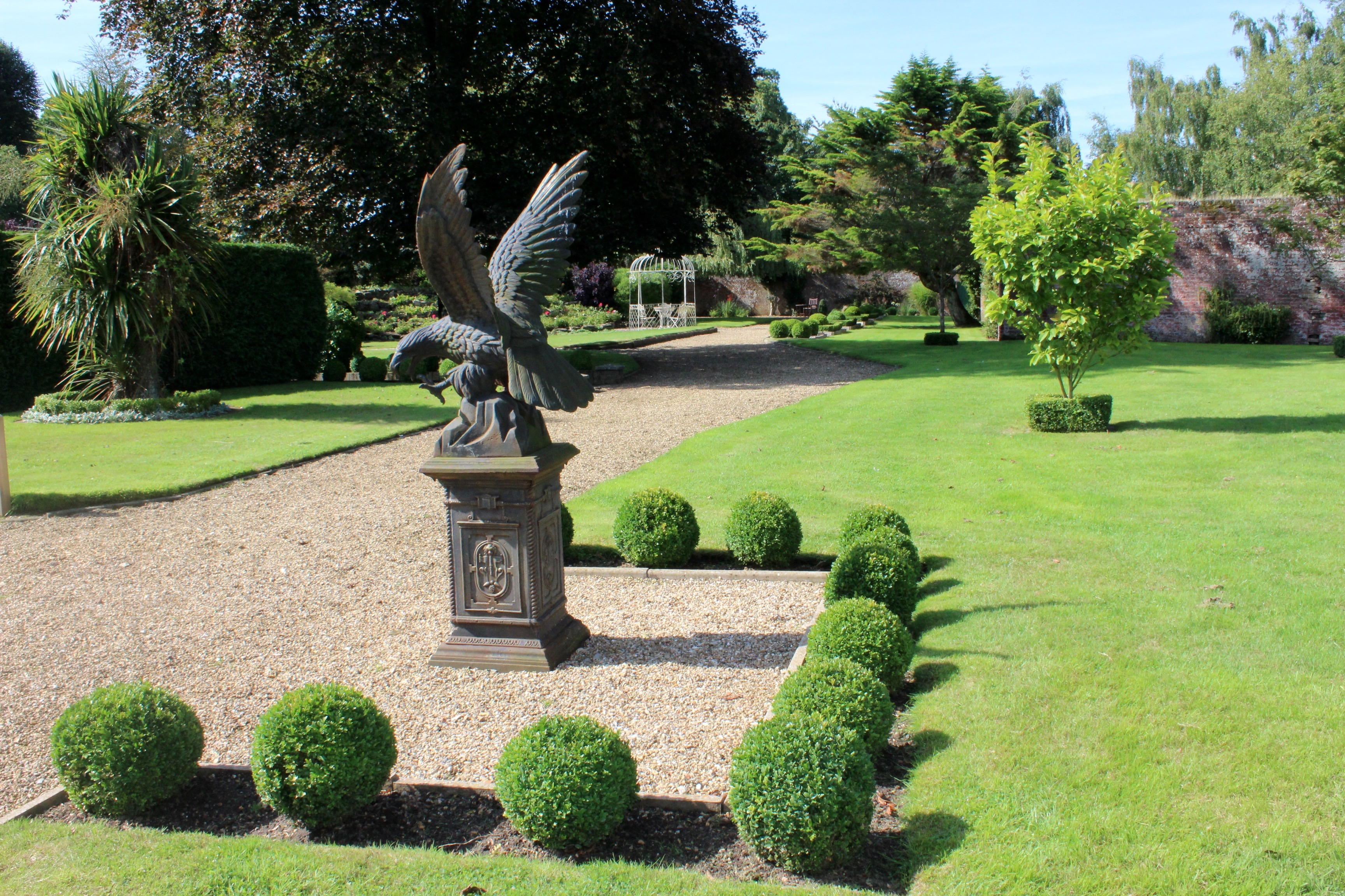 Walled garden eagle statue