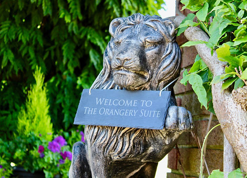 Welcome to The Orangery Suite lion statue