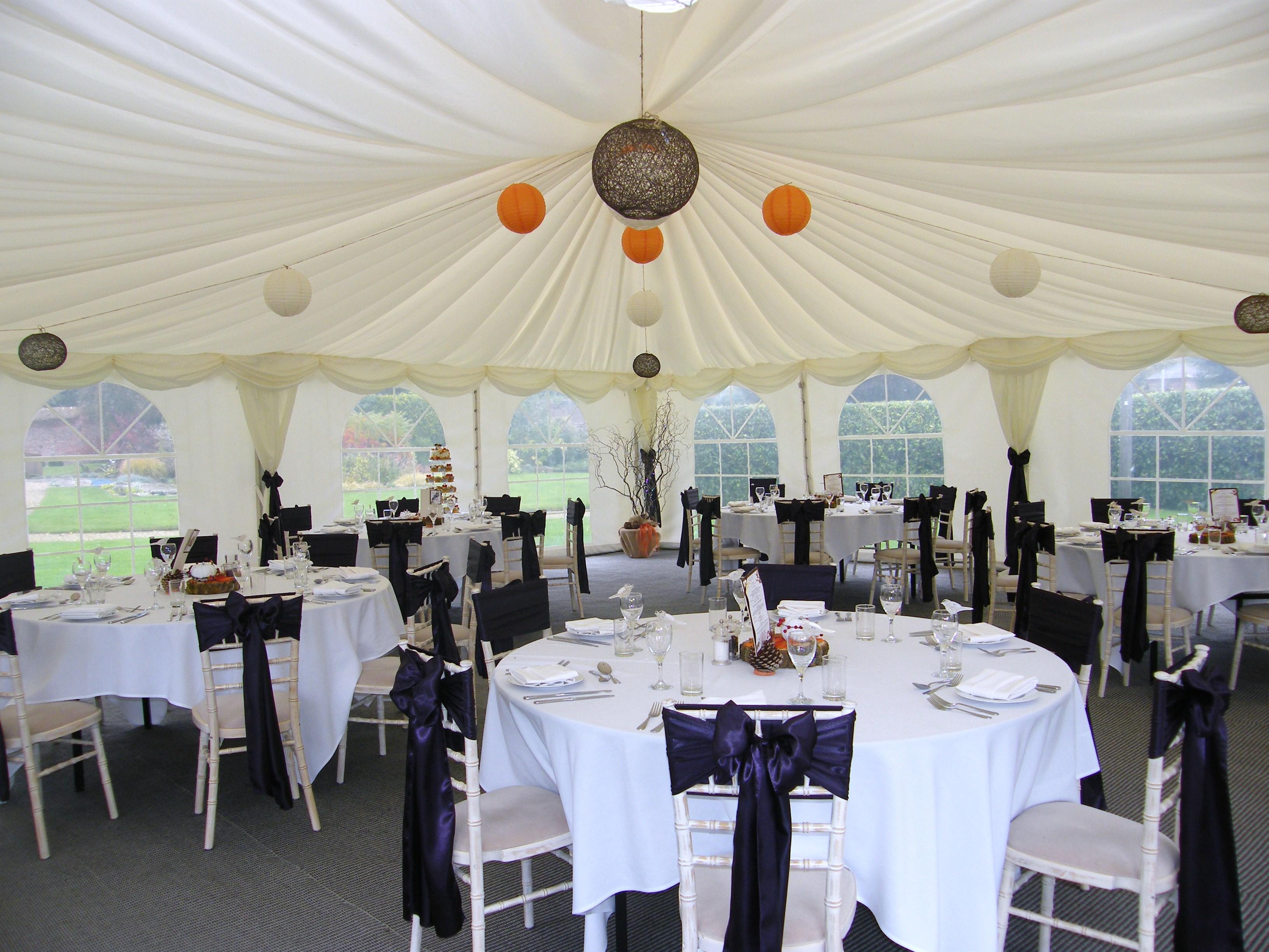 Marquee wedding reception round tables