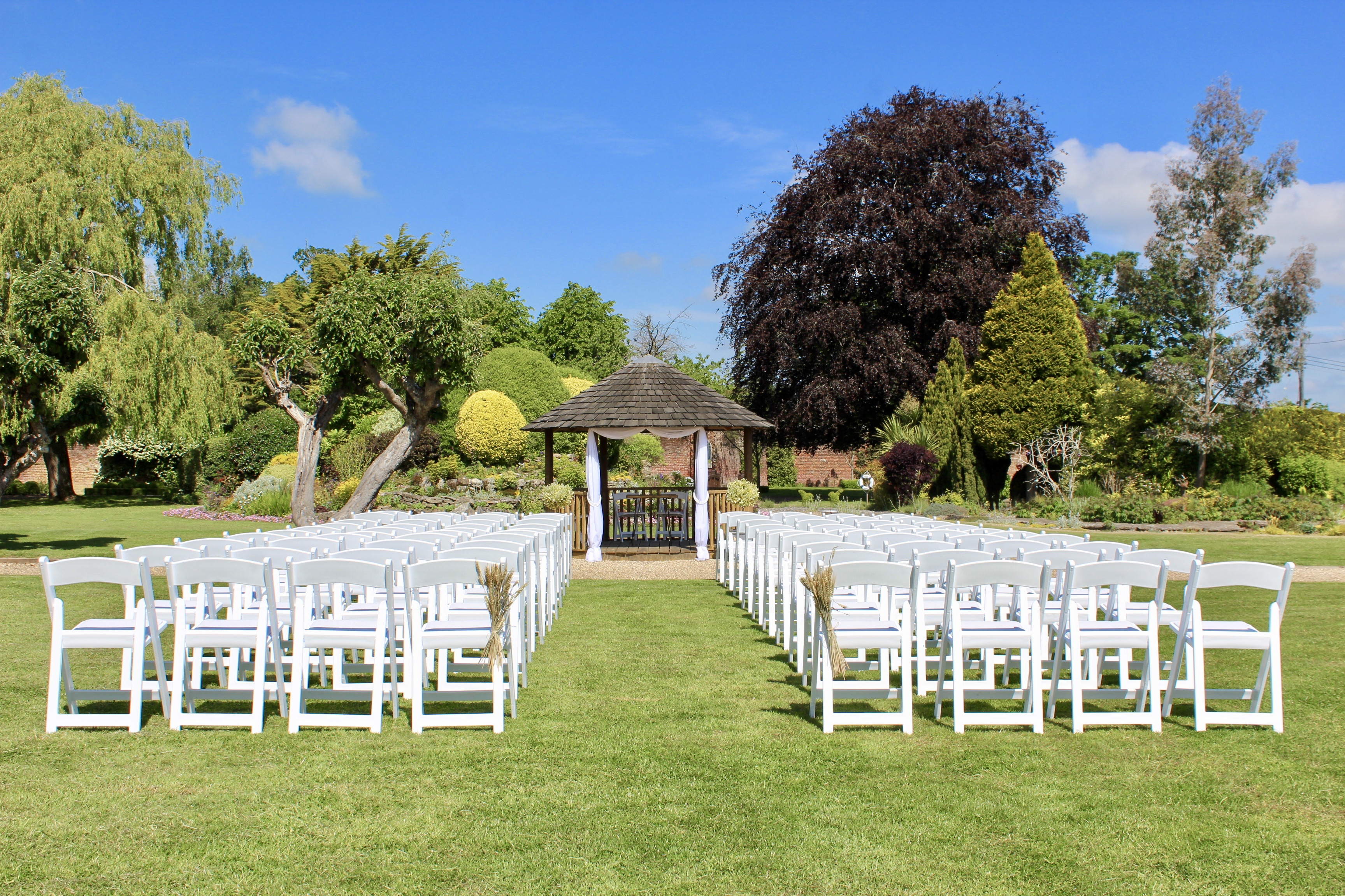 Outdoor wedding ceremony aisle chairs