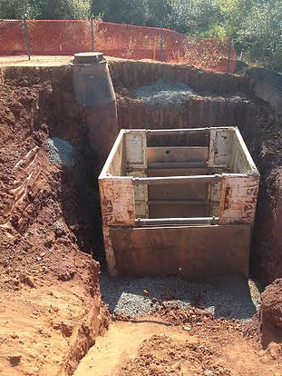A Trench Box is seen here protecting the work space 20 feet below ground!