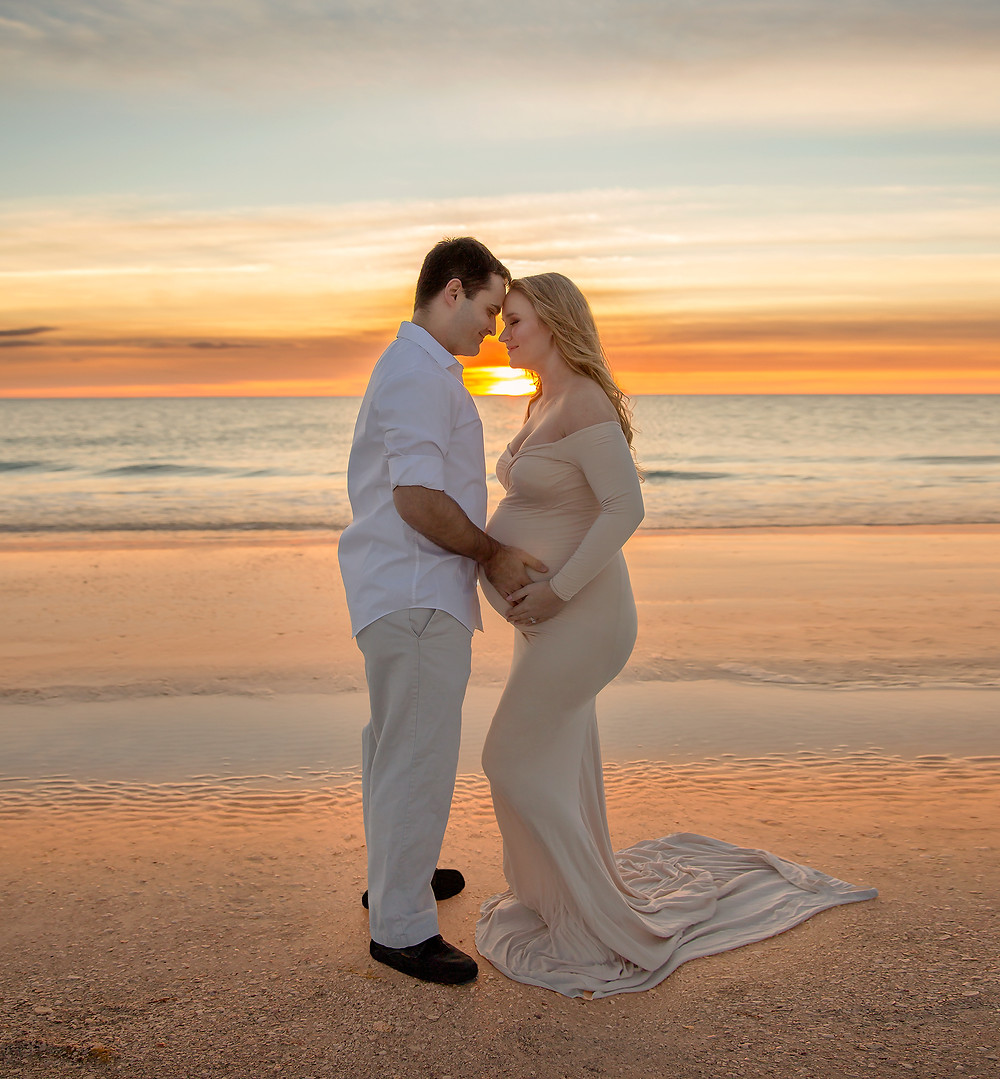 Sweet couple in at the beach in Tampa for pregnancy photos
