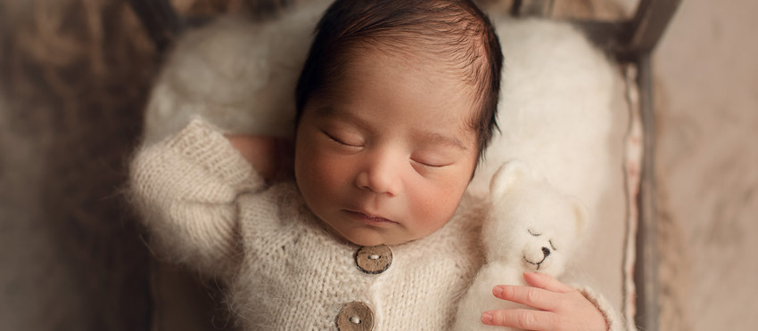 Newborn baby boy in neutral colors! Tampa's Premiere Newborn Photographer