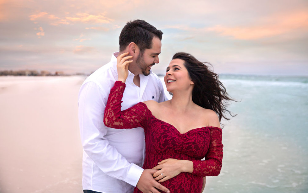 Maternity photos at Siesta key beach during sunset