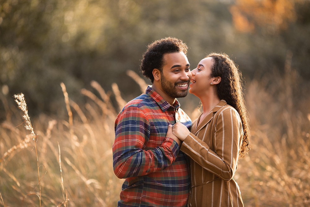 Couple cuddling during fall photo shoot in tampa