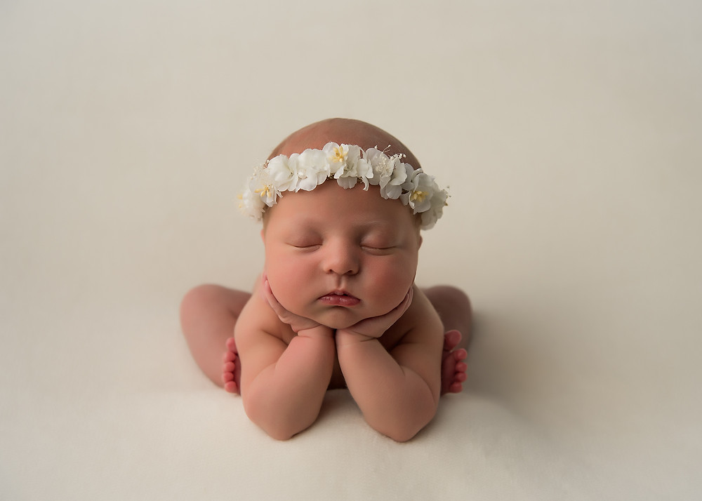 Tampa newborn photographer during newborn session. Sweet baby was so squishy and cute!