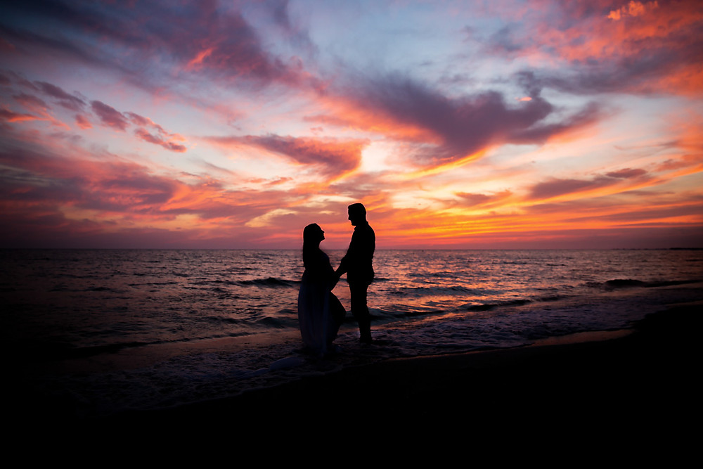 Silhoutte of Mother and Father on the beach during sunset! The colors are gorgeous in this image with pink, orange, and blue skies here in Tampa!