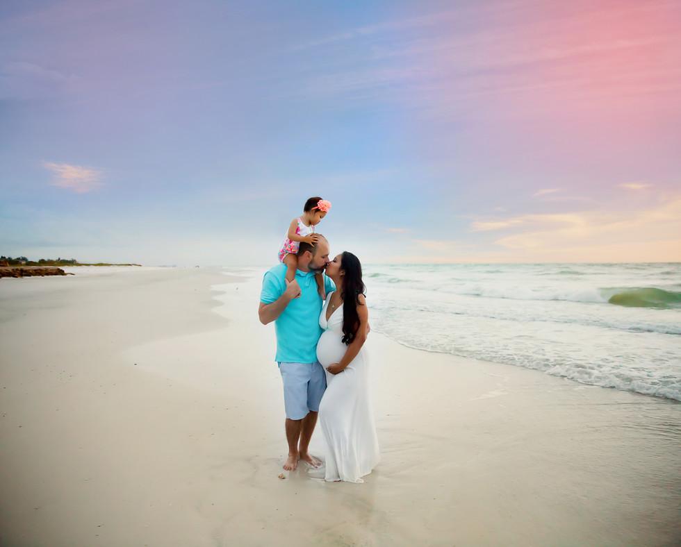 Beautiful sunset maternity beach session in Sarasota Fl by Rachel Rayne Photography