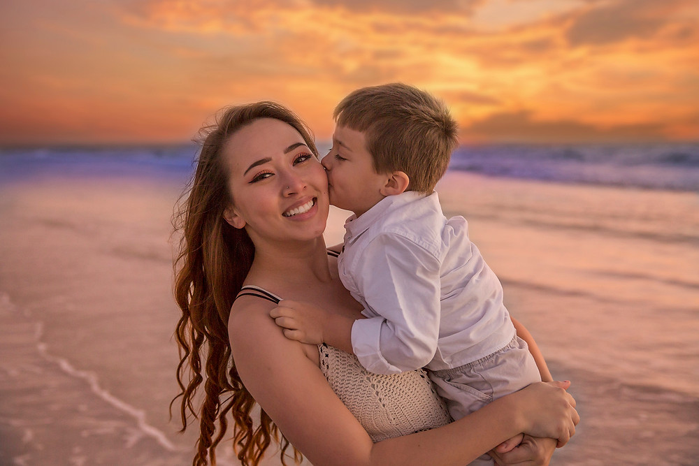 Sweet Son kisses during a family beach session here in Tampa fl!