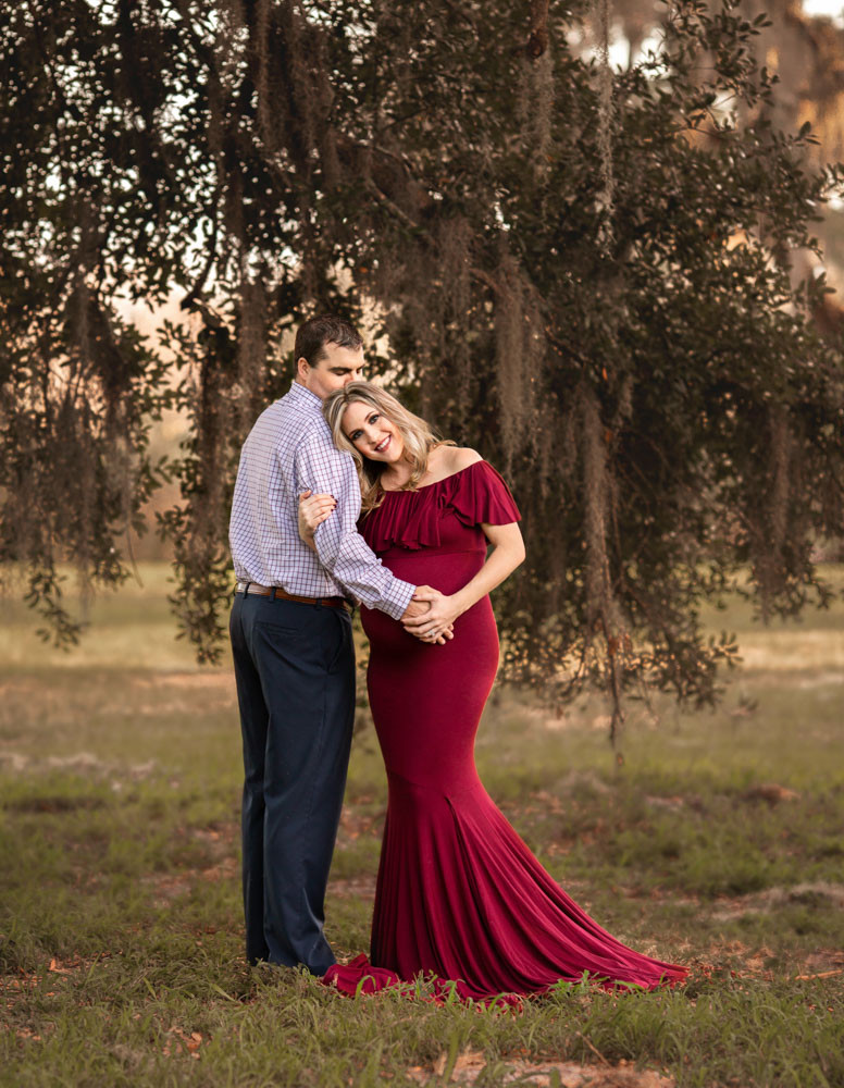 Sunset maternity photo shoot with expecting mother and father