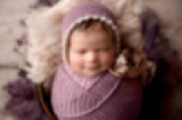 Neworn baby girl in tampa wearing lavender and bonnet