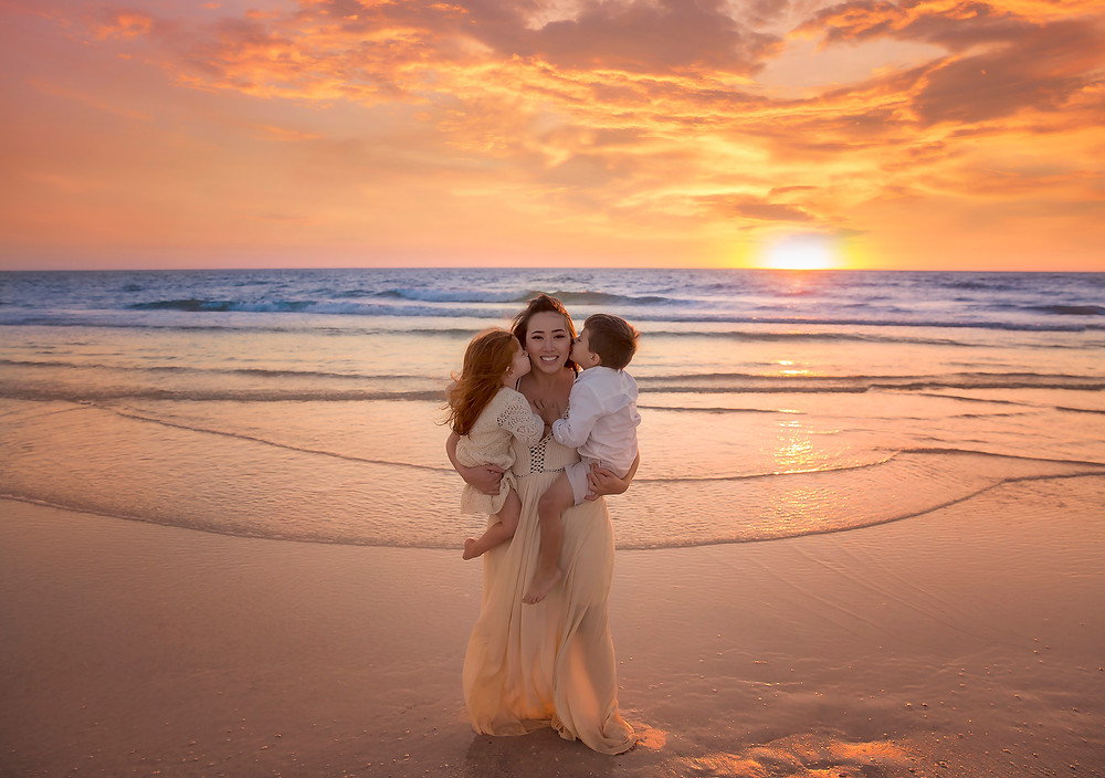 This Mama became a kiss sandwich during their family session at Siesta Key beach! I absolutely love the beaches of the Tampa bay area!