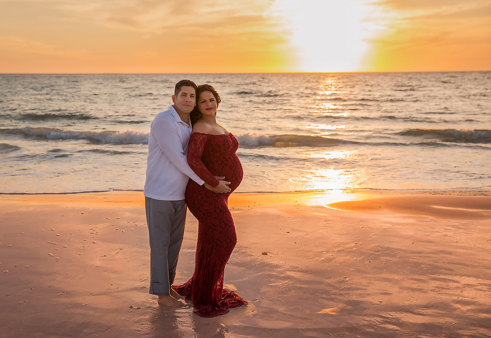 Pregnant couple on the beach