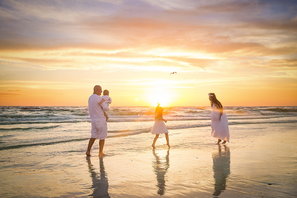 Lifestyle beach family photo session at Siesta Key beach in Tampa FL
