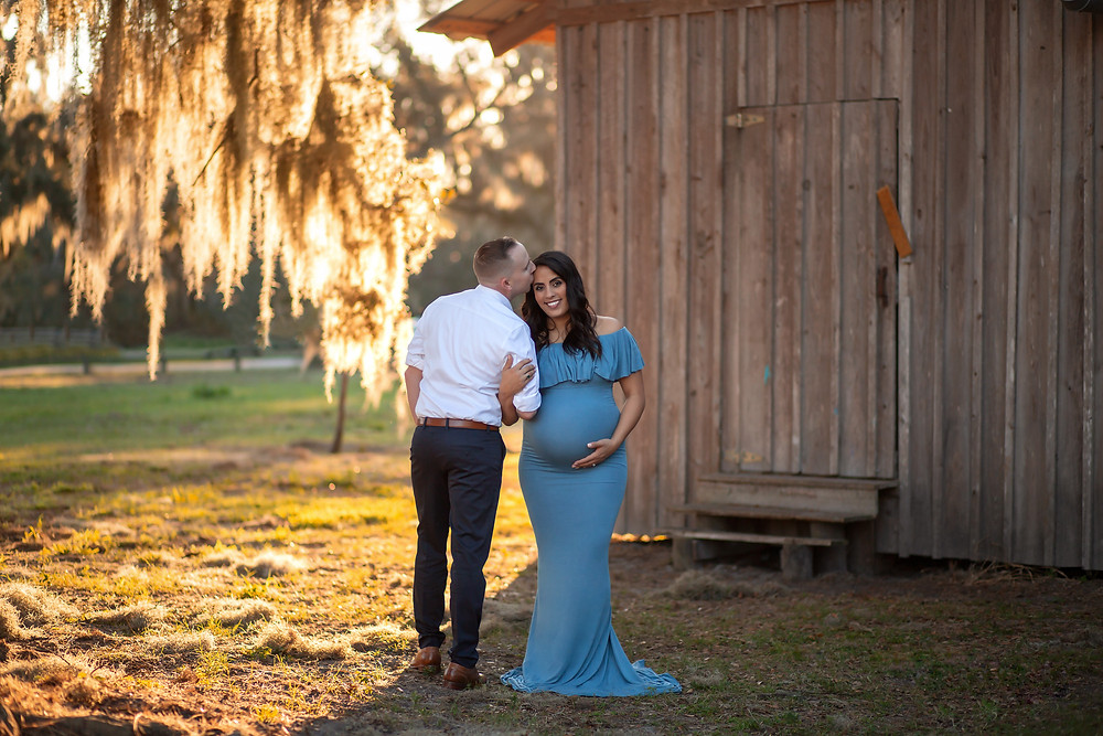 Pregnant mother wearing blue flowy gown in Tampa