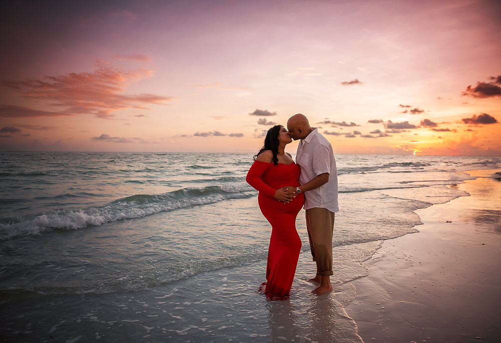 Sunset maternity is my favorite type of pregnancy photo to take! This Mother and father were kissing at sunset!