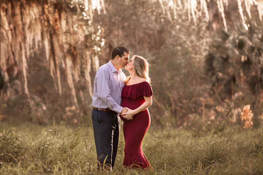 Pregnant Mother in red maternity gown in Tampa Florida maternity photos
