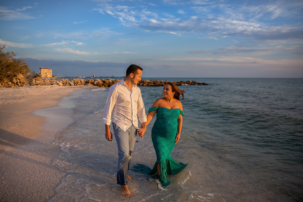 Couple walking on the beach during sunset at Tampa beach