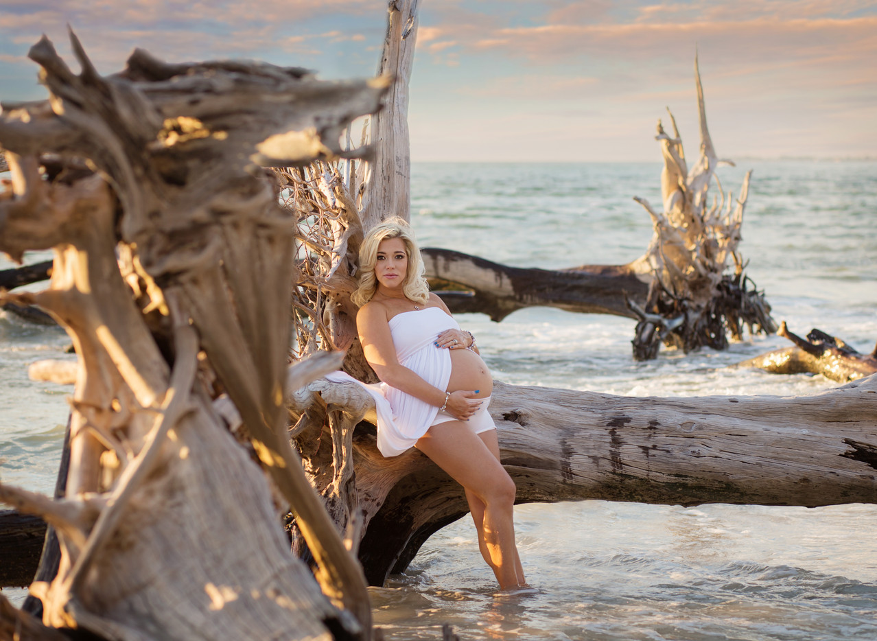 Pregnant woman leaning on tree