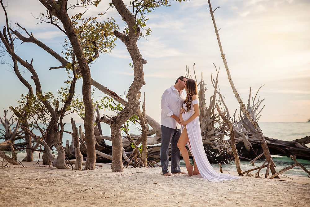 Maternity photos during this Mom's pregnancy at Driftwood beach! We went to Sarasota and she wore a gorgeous white maternity gown