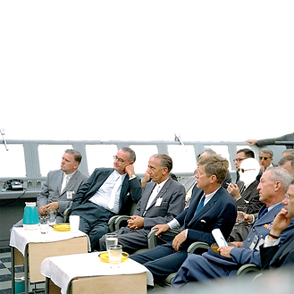 3_(1962) John F. Kennedy and Lyndon Johnson getting briefed at Cape Canaveral Launch Compl