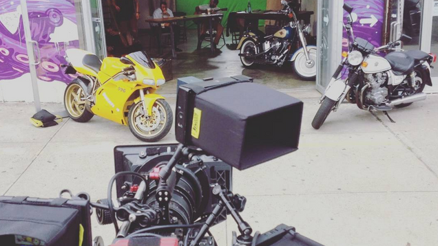 The magic of greenscreen is levearged to make this space look like a motorcycle plant.