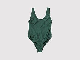 Botella verde del traje de baño