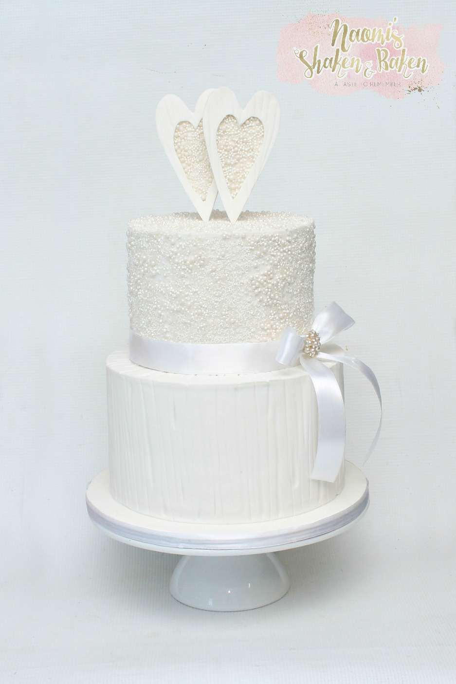 2 tiered white wedding cake