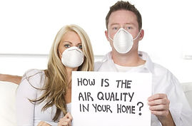 couple-on-couch-wearing-dust-masks-featu