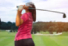 Women player golf swing shot on course .