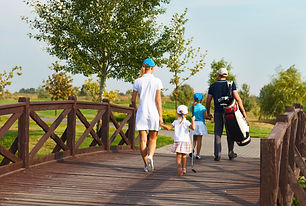 Happy young family in golf country club.