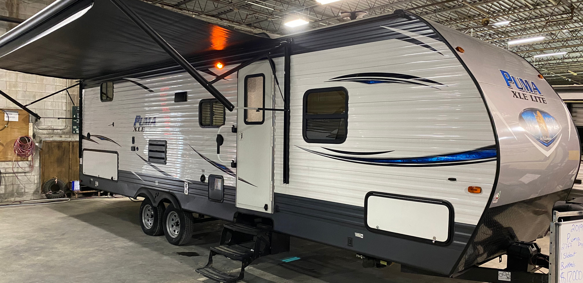 019 Palomino Puma XLE lite. Model number is 27RBQC. it is 27ft long, dry weight is 6000lbs. Has one slideout. Electric awning and electric stabilizer jacks!! Big outside storage area. Inside is very beautiful bunk beds in the back corner. Fold down table and couch. Does have a queen bed in the front!  Everything works as it should.  Does have a rebuilt title. $17,000.